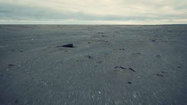 Aerial view of empty Iceland beach with dramatic clouds in background. Royalty-free stock video