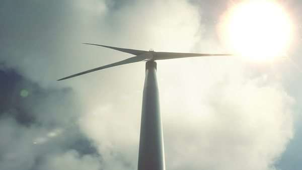 Wind turbine view from bottom against moving clouds Royalty-free stock video
