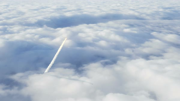 Rocket penetrating through the clouds leaving trail of smoke in its wake Royalty-free stock video