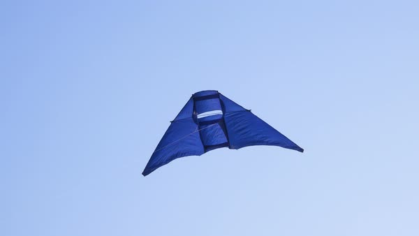 Blue kite filling frame against a clear blue sky Royalty-free stock video