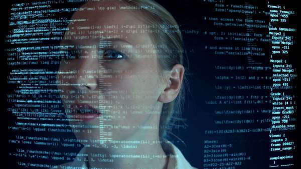 Futuristic worker observing overlayed layers of code in front of her Royalty-free stock video