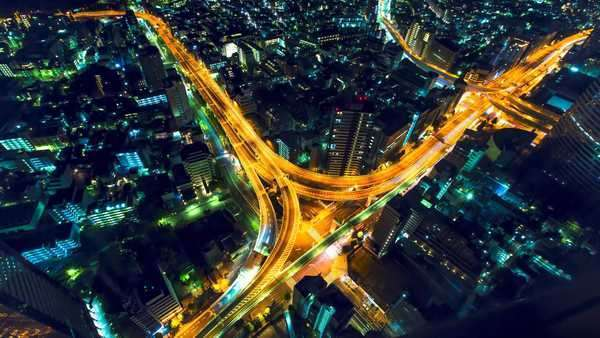 Aerial view timelapse of a massive highway intersection at night in Shinjuku, Tokyo, Japan. Royalty-free stock video
