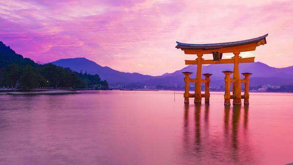 Sunset timelapse of the famous orange shinto gate (Torii) of Miyajima island of Hiroshima prefecture, Japan. Royalty-free stock video