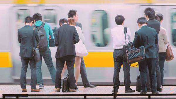 People waiting to board a train at the subway station in Tokyo, Japan Royalty-free stock video