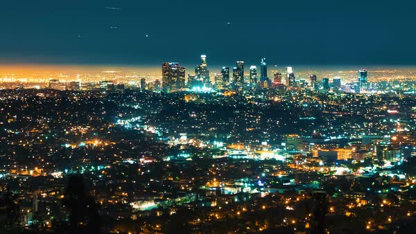 Timelapse of downtown Los Angeles from above at night with planes circling Royalty-free stock video
