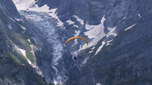 Paraglider soaring above an alpine valley Royalty-free stock video