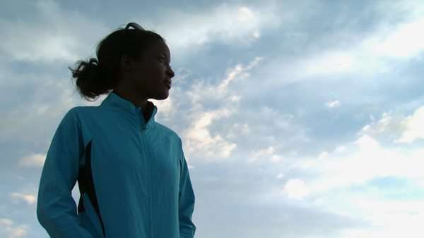 Woman standing outdoors with blue sky and clouds Royalty-free stock video