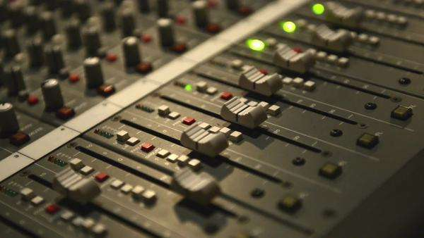 Analog audio mixing board with several channels and push buttons visible Royalty-free stock video