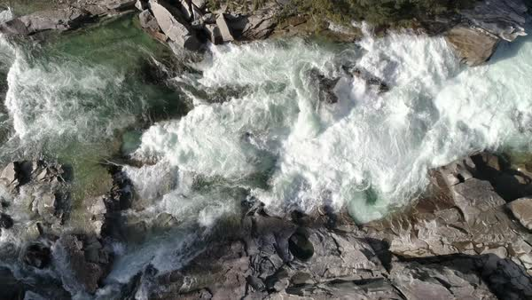 Ultra Real Nature Aerial of Raging Canyon River with Epic White Water Rapids from Birds Eye View Royalty-free stock video