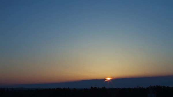 Timelapse of summer sunrise with blue sky and clouds in wide angle. Royalty-free stock video