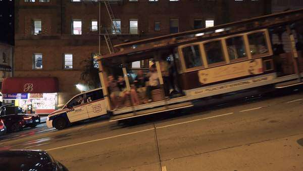 SAN FRANCISCO - October 2015 - A San Francisco cable car climbs a steep hill at night. Royalty-free stock video