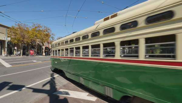 SAN FRANCISCO - October, 2015 - A street car passes through an intersection on Market Street near Castro Street in San Francisco.    Royalty-free stock video