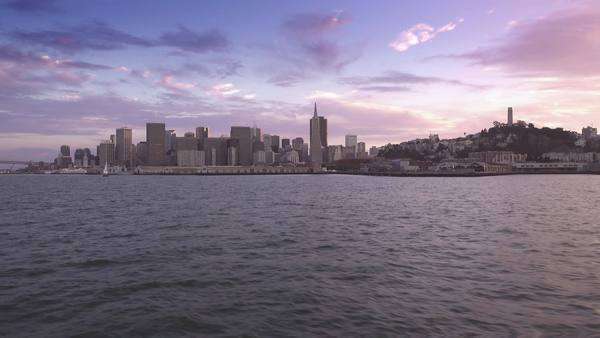 The San Francisco skyline at sunset as seen from a boat on San Francisco Bay.  	 Royalty-free stock video