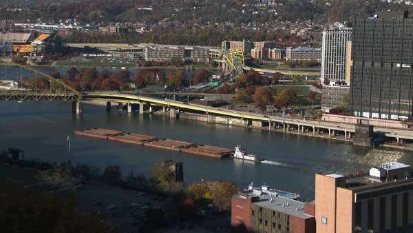 A barge heads up the Monongahela River near Pittsburgh, Pennsylvania. Royalty-free stock video