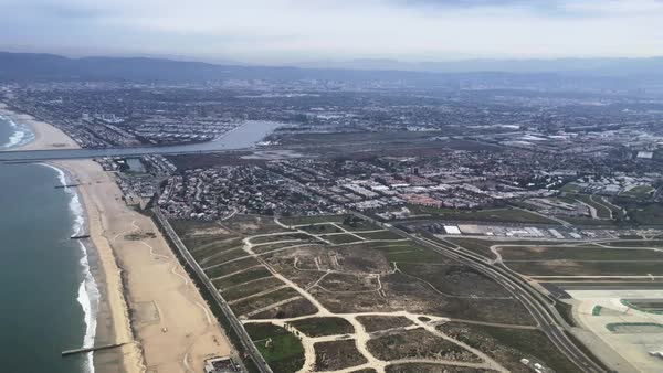 A passenger's aerial view of the coastline of southern California.  	 Royalty-free stock video