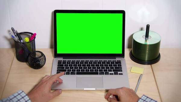 A man taps his fingers on his desk waiting for his laptop to operate. Royalty-free stock video