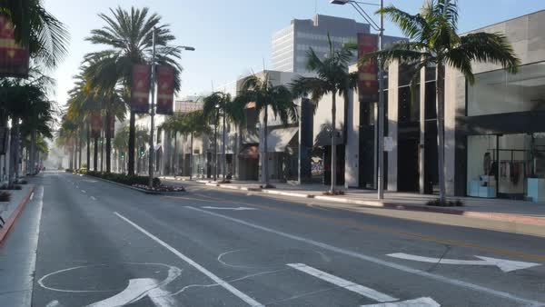 BEVERLY HILLS, CA - February, 2016: An establishing shot of an empty Rodeo Drive in the morning.  	 Royalty-free stock video