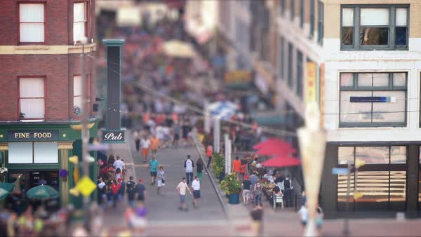 CLEVELAND, OH - Circa August, 2014 - A tilt shift establishing shot of the busy and popular East 4th Street in downtown Cleveland, Ohio. Royalty-free stock video
