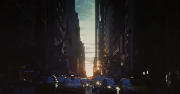 "NEW YORK - Circa July, 2016 - A sunset establishing shot of ""Manhattanhenge"" as seen down 44th Street in Manhattan. Royalty-free stock video"