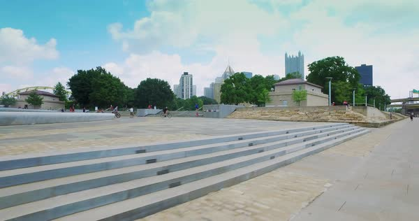 A dolly establishing shot of Point State Park and the downtown Pittsburgh on a summer day.  	 Royalty-free stock video