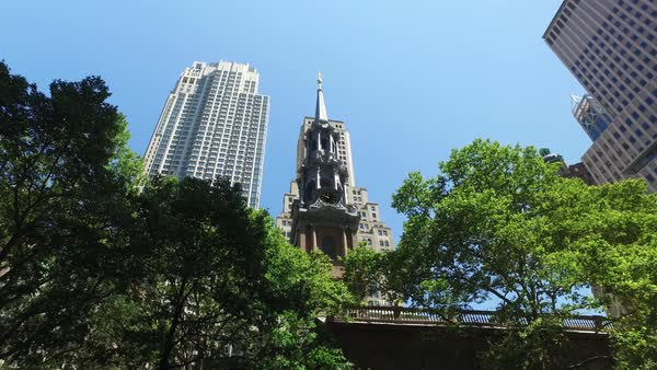 A daytime establishing shot of looking up at the steeple of St. Paul's Chapel of Trinity Church Wall Street in lower Manhattan.  	 Royalty-free stock video