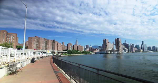 A rider's perspective on the East River Bikeway near Stuyvesant Town with the Empire State Building in the distance.  	 Royalty-free stock video