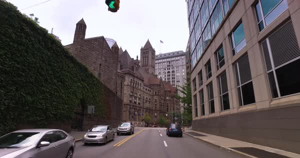 September, 2016 - A driving perspective approaching the Allegheny County Courthouse in downtown Pittsburgh.  	 Royalty-free stock video