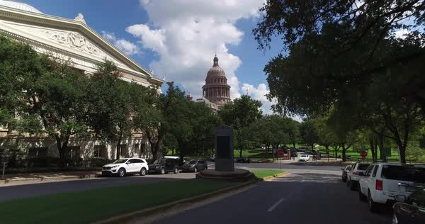 A driver's perspective on the streets around the Capitol Building in downtown Austin, Texas.  	 Royalty-free stock video