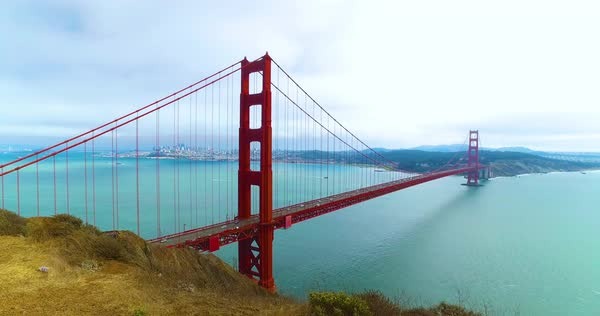 A rising dolly up shot of the Golden Gate Bridge on a foggy overcast day. Royalty-free stock video