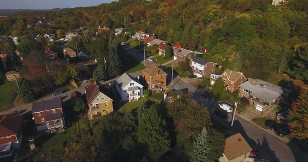 An aerial view above a small Western Pennsylvania town and neighborhood on an Autumn evening. Pittsburgh suburb. Royalty-free stock video