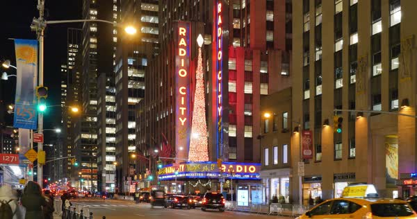 NEW YORK - Circa December, 2016 - A night time lapse view of the famous Radio City Music Hall decorated for the Holiday season.  	 Royalty-free stock video