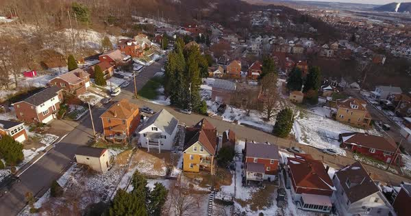 A slowly moving forward aerial winter view of a typical Western Pennsylvania residential neighborhood. Royalty-free stock video
