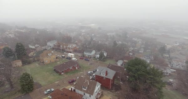 A slowly rotating aerial snowing winter view of a typical Western Pennsylvania residential neighborhood. Royalty-free stock video