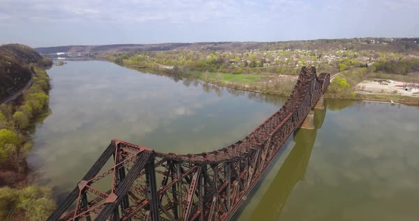 MONACA, PA - Circa April, 2017 - A daytime aerial view of a railroad bridge on the Ohio River in Western Pennsylvania. Royalty-free stock video