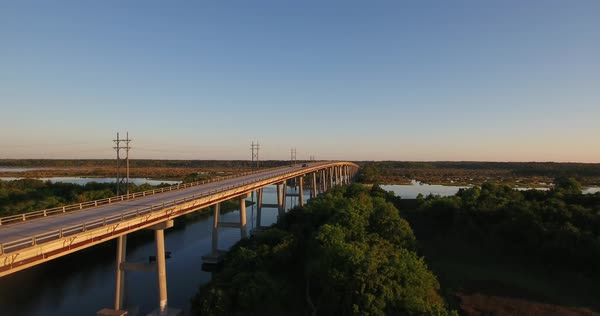 An early morning sunrise rising aerial establishing shot of the Topsail Island Bridge over the Intracoastal Waterway. Royalty-free stock video