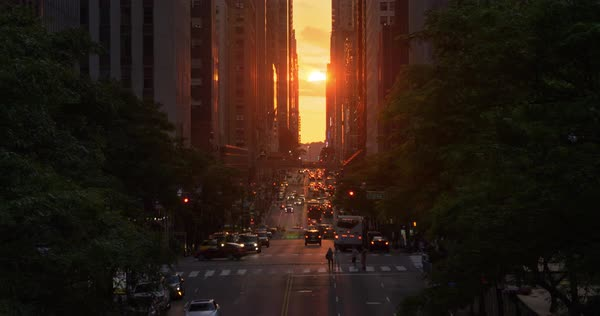 "A dramatic wide evening long establishing shot over 42nd Street in New York City during the ""Manhattanhenge"" solar event. Royalty-free stock video"