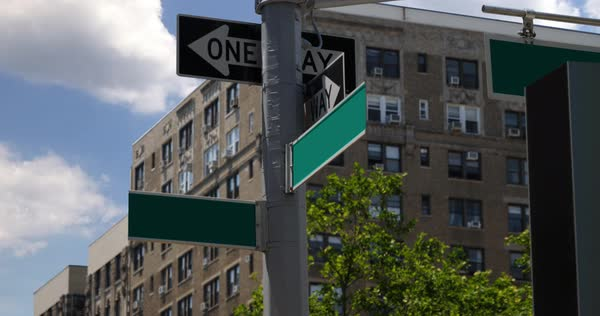 A daytime establishing shot of two blank street location signs in Manhattan.  Royalty-free stock video