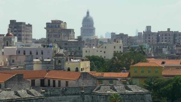 A high angle dolly establishing shot of the capitol dome in the old town section of Havana, Cuba. Royalty-free stock video