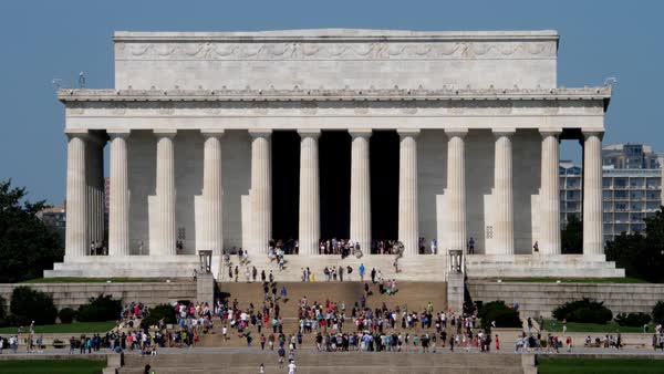 WASHINGTON, D.C. - Circa August, 2017 - A sunny daytime extreme long shot of tourists visiting the Lincoln Memorial on the Washington Mall. Shot in 5K.   Royalty-free stock video