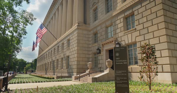 A daytime summer exterior establishing shot of the Herbert Hoover Building in Washington, D.C. Royalty-free stock video