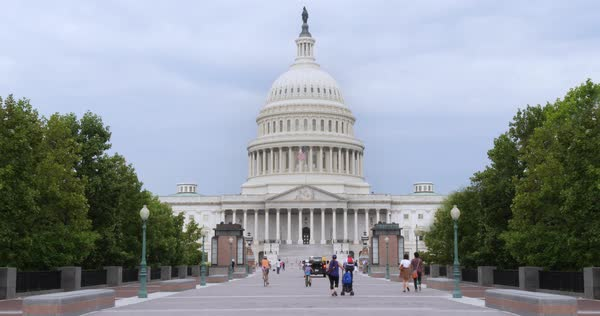 Tourists visit the Capitol Building on Capitol Hill on an overcast summer day.  Royalty-free stock video