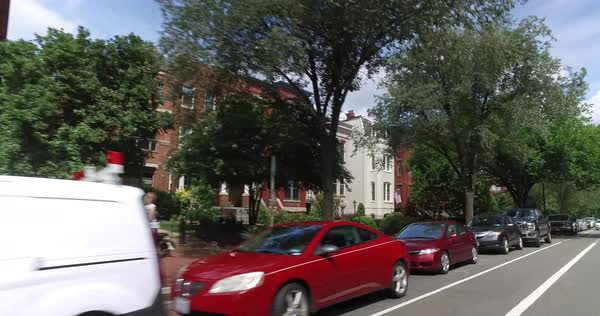 A rear profile driving perspective past typical Capitol Hill residences in Washington DC.  Royalty-free stock video