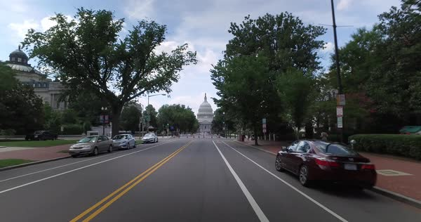 A forward perspective driving on East Capitol Street headed to the Capitol Building in Washington DC.  Royalty-free stock video
