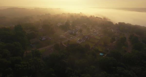 An early foggy morning forward aerial establishing shot of a typical Western Pennsylvania residential neighborhood. Pittsburgh suburb.   Royalty-free stock video