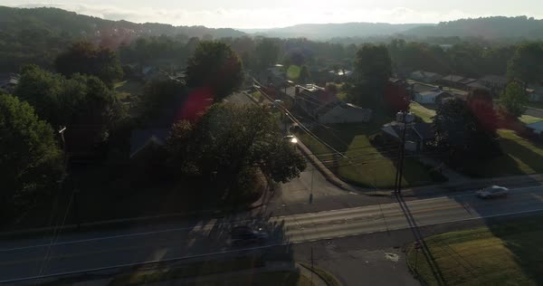 Hovering over a typical Western Pennsylvania street on an early foggy autumn morning.   Royalty-free stock video