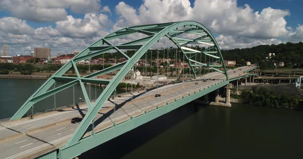 A daytime aerial establishing shot of traffic passing over the Birmingham Bridge over the Monongahela River near Pittsburgh, PA.   Royalty-free stock video