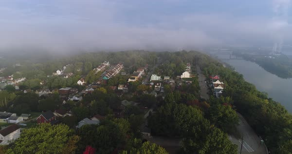 An early morning foggy aerial establishing shot of a typical Pittsburgh residential neighborhood. Royalty-free stock video