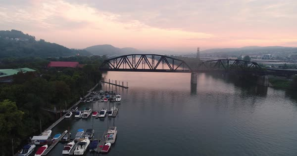 An early morning foggy aerial establishing shot of a marina on the Allegheny River outside of Pittsburgh, Pennsylvania.   Royalty-free stock video