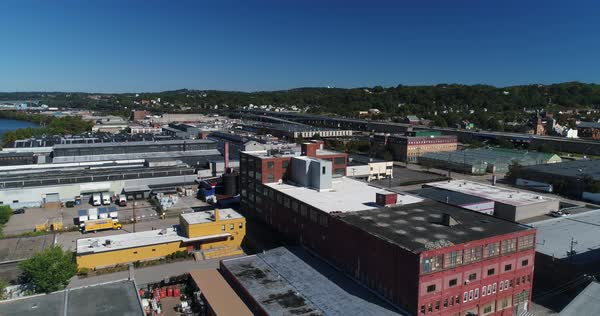 A daytime aerial establishing shot of the various businesses and warehouses along the Ohio River shoreline on Pittsburgh's west end district.   Royalty-free stock video