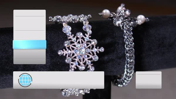 A fictional home shopping television content screen. Slowly rotating silver jewelry items with blank text boxes along the sides Royalty-free stock video